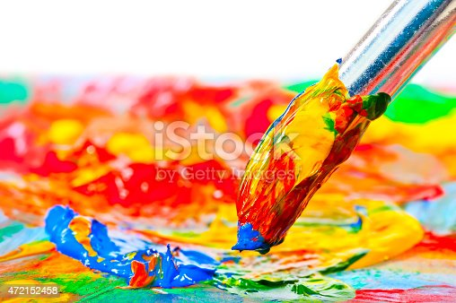 istock brush stained with acrylic paints, close-up shot 472152458