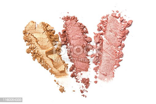 istock Brush stroke of shiny crushed pink and golden eye shadow 1160054333