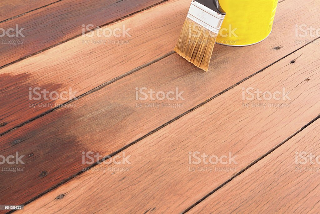 brush tin and decking oil for a timber deck stock photo