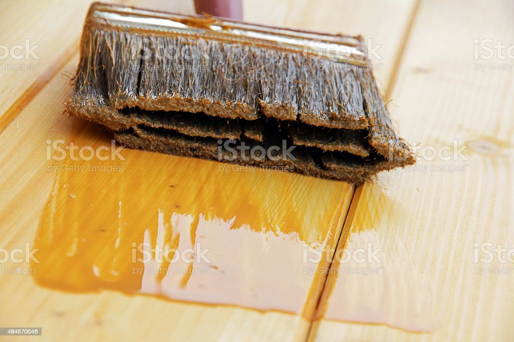 Brush with wood preservative stock photo