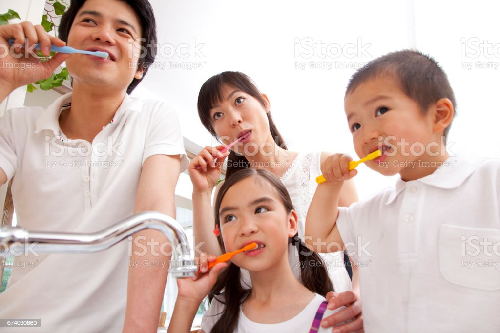 Brush your teeth with a family royalty-free stock photo