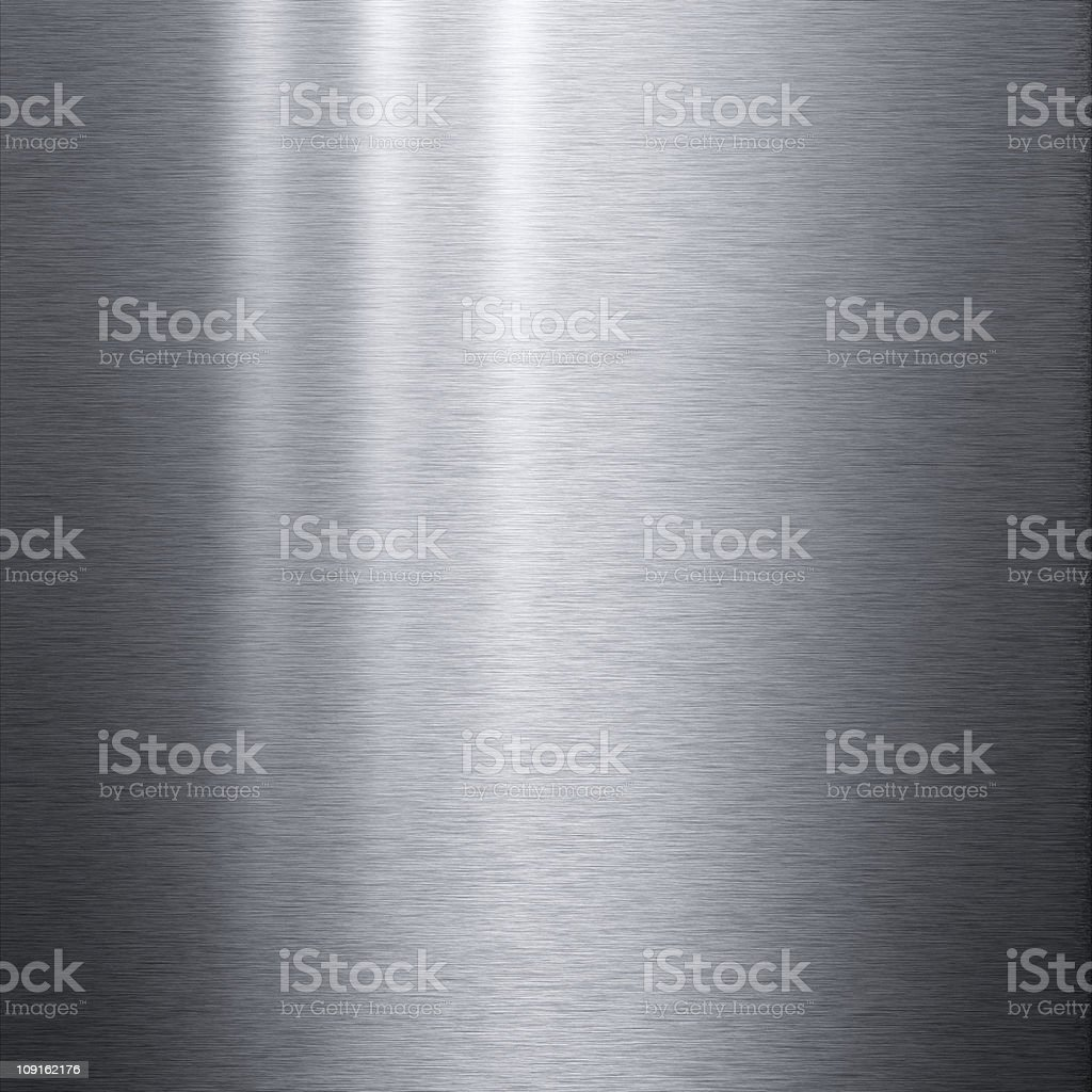 Brushed aluminum metallic plate with light reflecting on it royalty-free stock photo