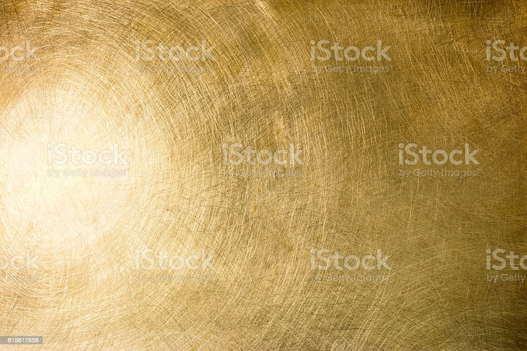 brushed brass plate with multiple scratches and light reflection stock photo