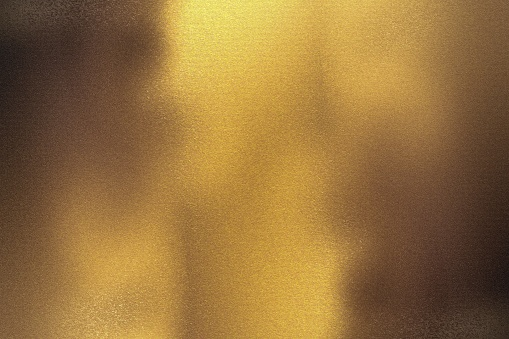 istock Brushed bronze foil metallic wall with glowing shiny light, abstract texture background 1198800945