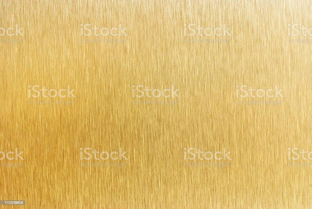 Brushed gold metal surface stock photo