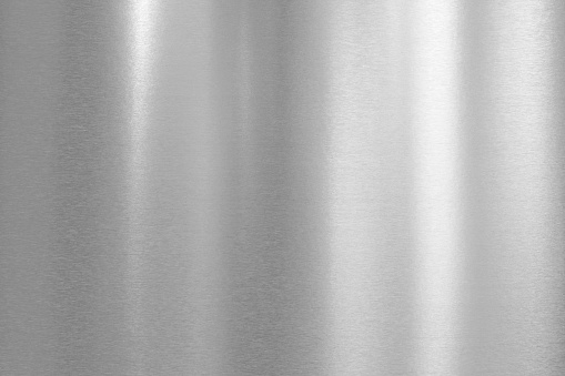 Shiny stainless steel with brushed surface and light reflections.