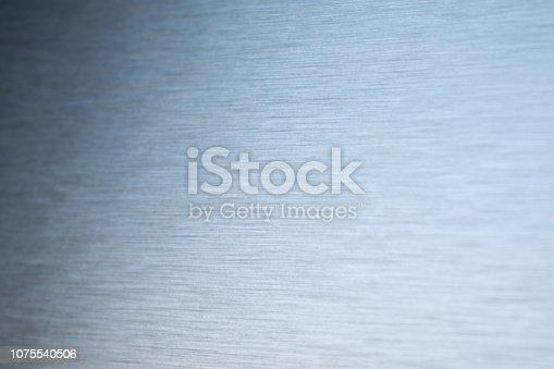 699231430 istock photo Brushed metal texture 1075540506