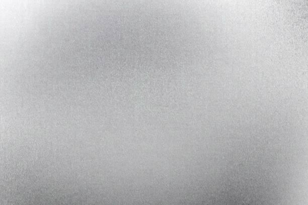 gebürstetes silber blech, abstrakte textur hintergrund - folien highlights stock-fotos und bilder