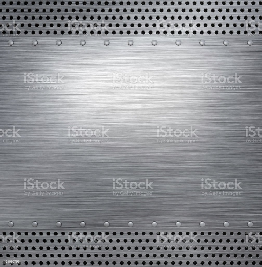 Brushed steel metal plate with holes at the top and bottom royalty-free stock photo