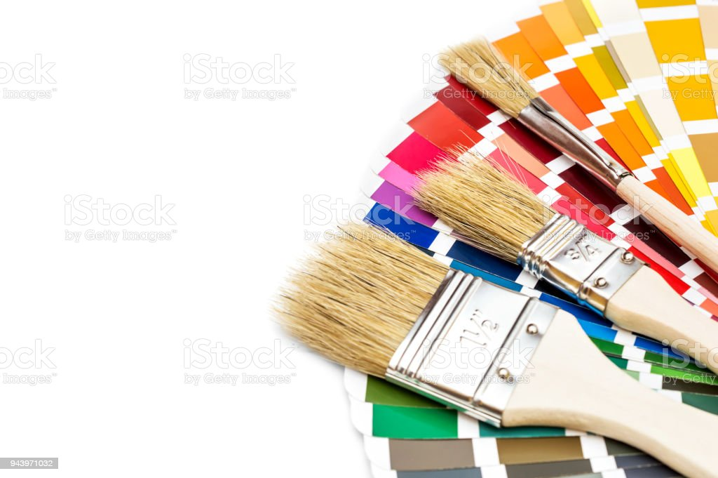 Brushes and color swatches book on white background. stock photo