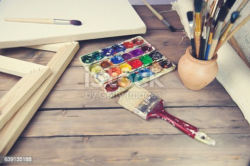 1062226450 istock photo brushes, canvas, watercolor on the table 639135188
