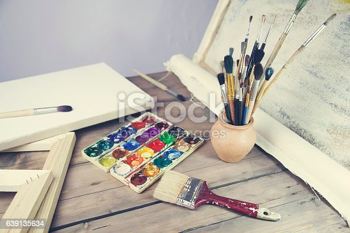 1062226450 istock photo brushes, canvas, watercolor on the table 639135634