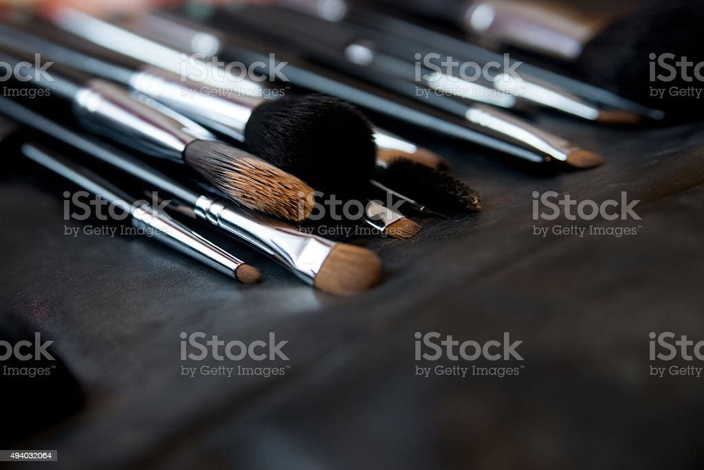 Brushes for make up on leather background stock photo