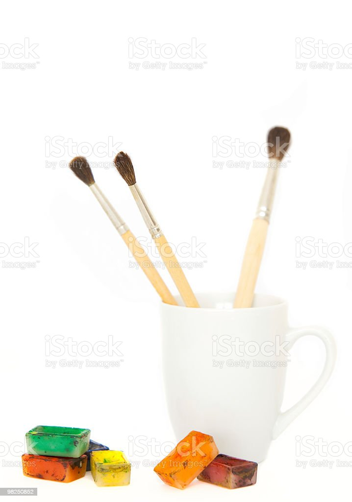 Brushes in a mug with paints royalty-free stock photo