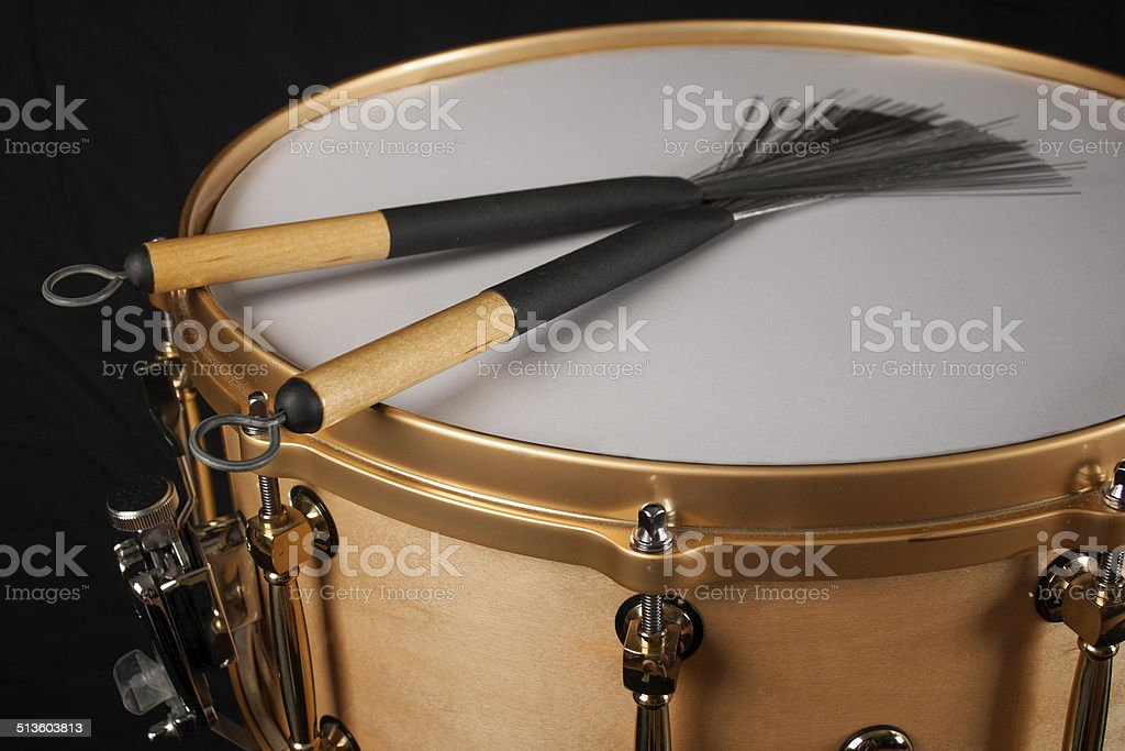 Brushes on a snare drum stock photo