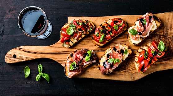 istock Brushetta set and glass of red wine. Small sandwiches with 544722402