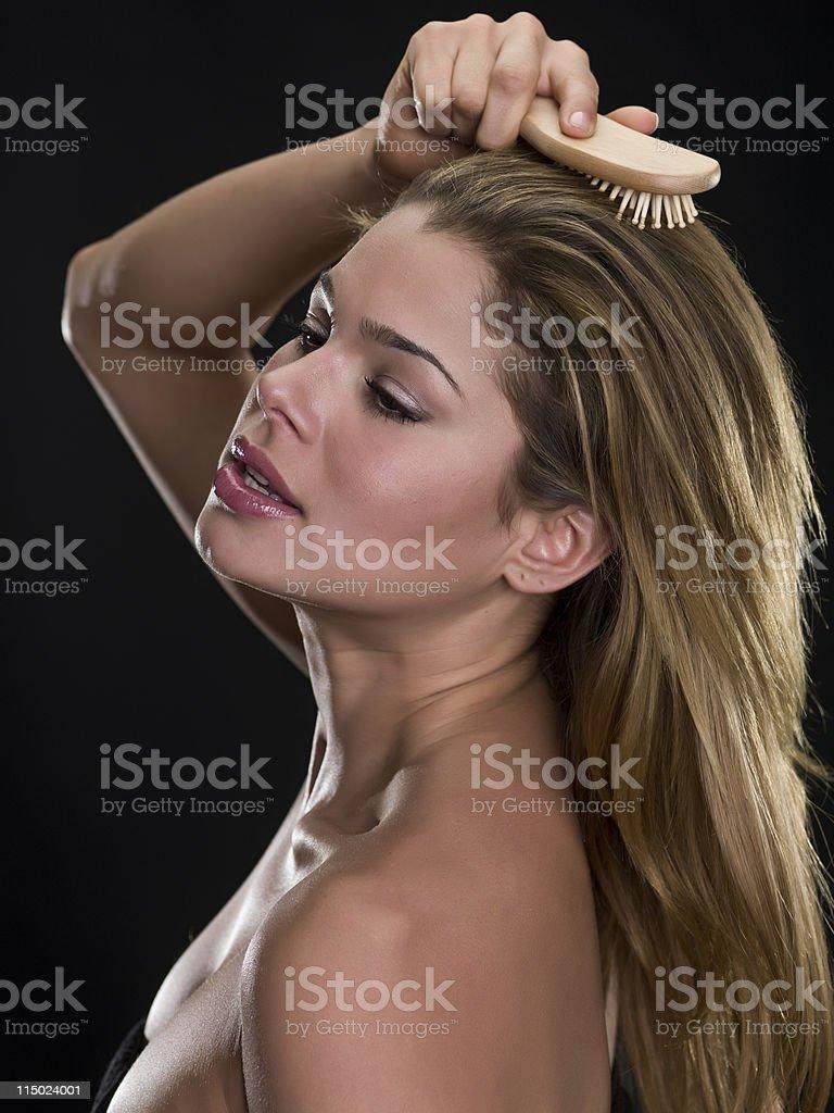 Brushing her hair royalty-free stock photo