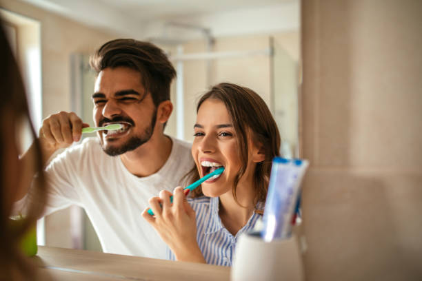 Brushing my teeth Couple doing a morning hyginene together. teeth stock pictures, royalty-free photos & images