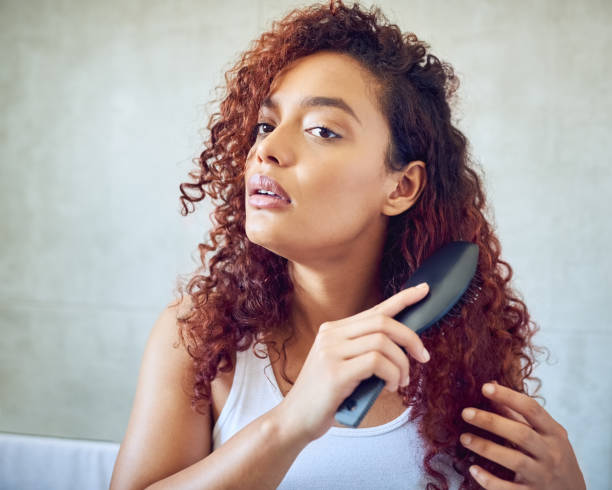Brushing out those curls stock photo
