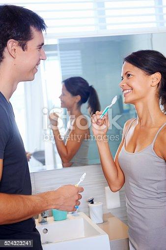 874030164 istock photo Brushing teeth couple 524323241