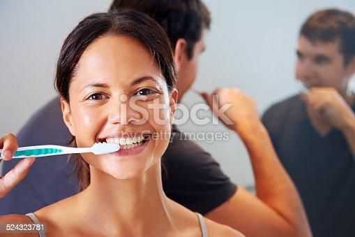 874030164 istock photo Brushing teeth couple 524323781