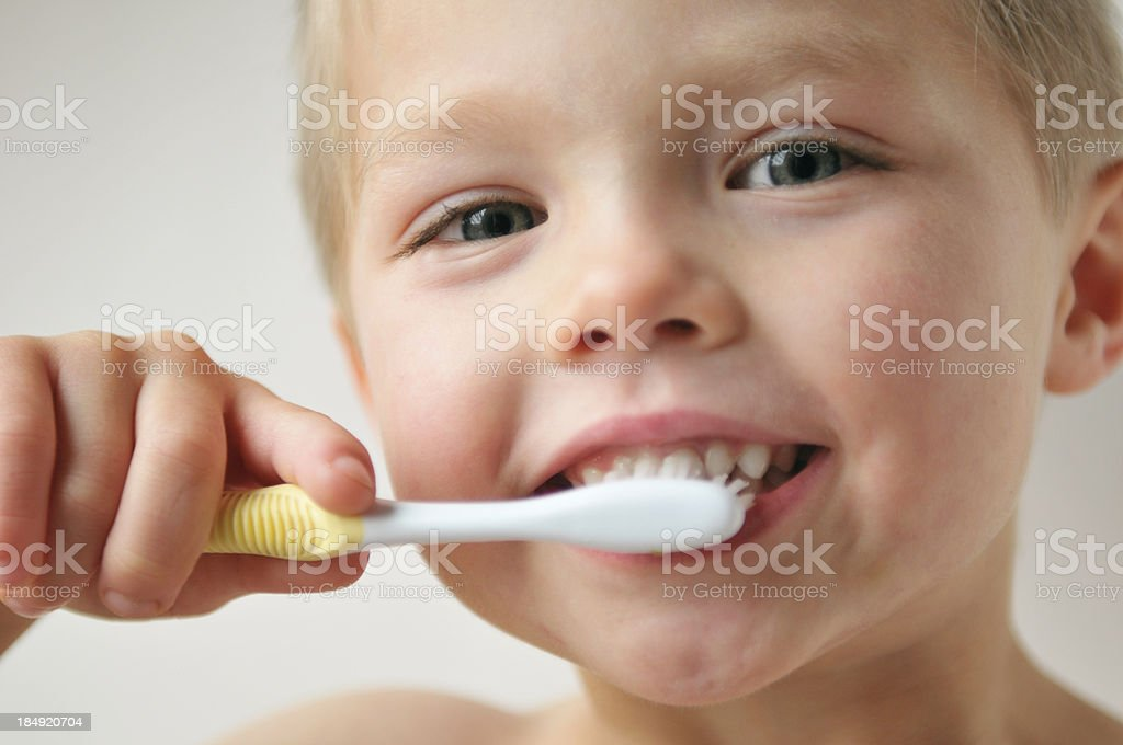 Brushing Teeth Little boy brushing his teeth. Boys Stock Photo
