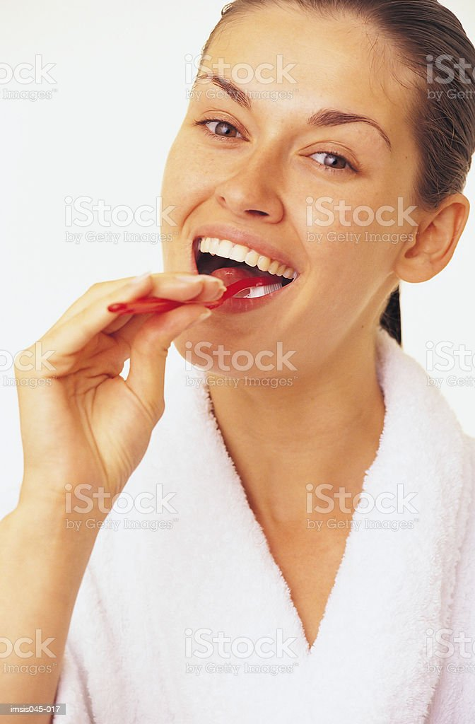 Brushing teeth royalty free stockfoto