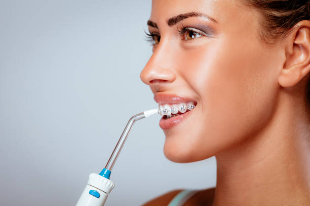 Brushing Teeth With Braces stock photo