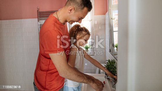 684029036 istock photo Brushing teeth with dad in our bathroom 1155623618