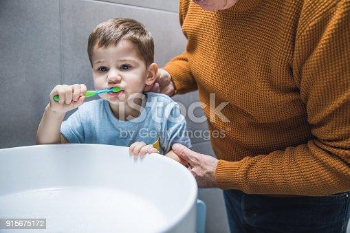 912658656 istock photo Brushing the teeth 915675172
