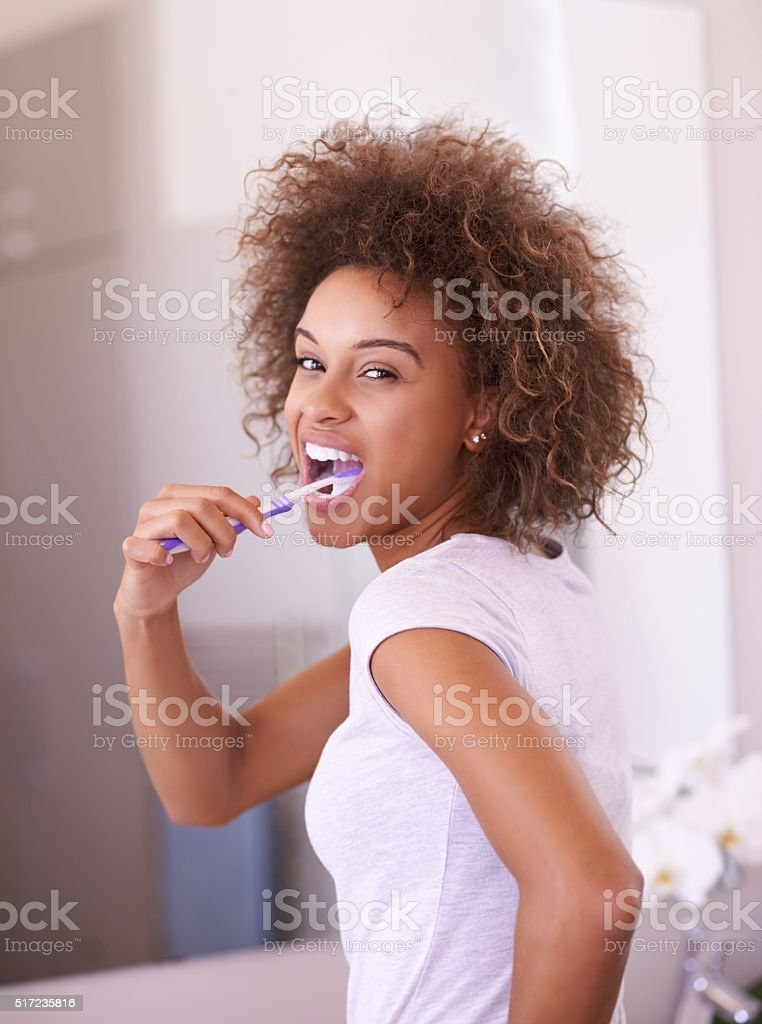 Brushing with toothpaste is important for several reasons stock photo