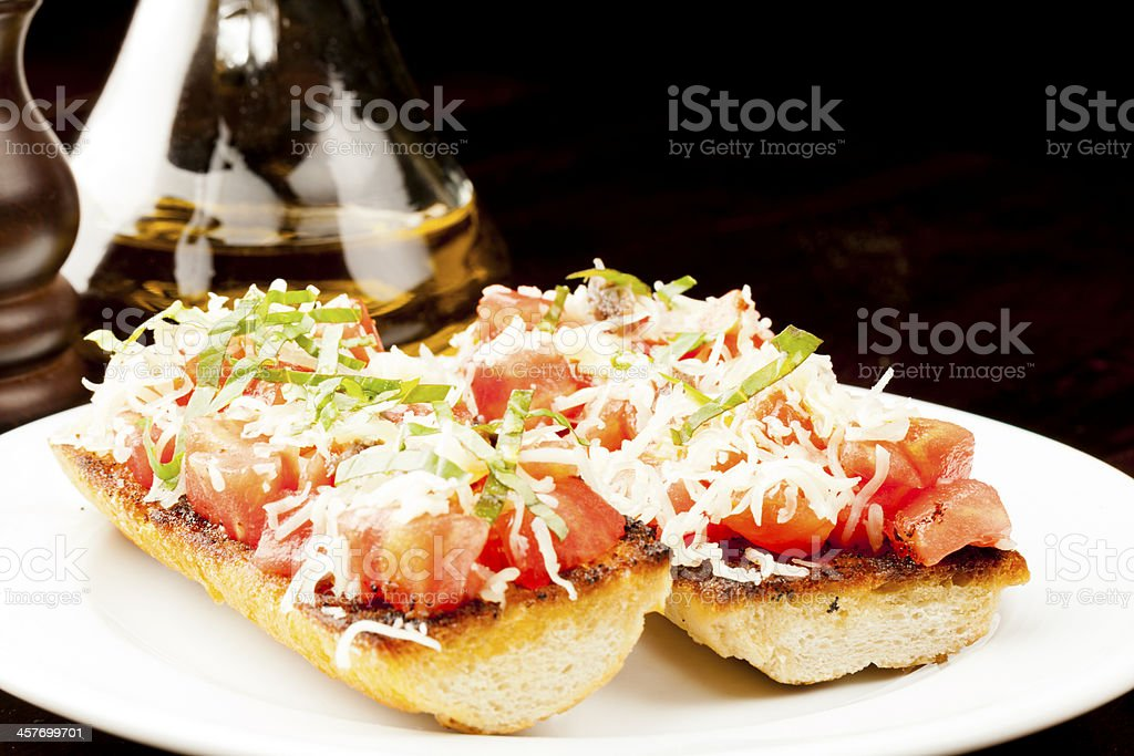 Brusketti close-up whit oil and peper in backfround royalty-free stock photo