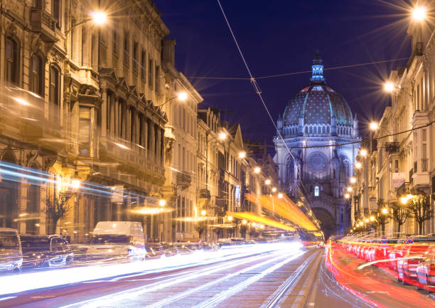 Brussels (Bruxelles), Belgium: Nigh view of the Belgian Capital, car light trails on Rue Royal street, view on Saint Mary's Royal Church stock photo