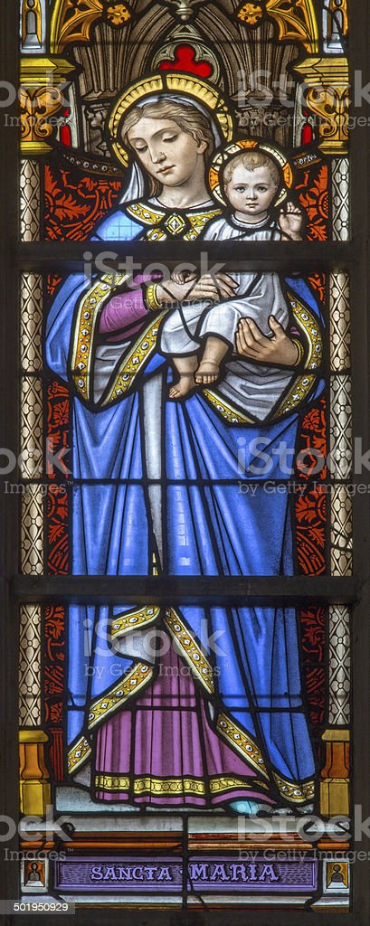 Brussels - Madonnna on windowpane in the cathedral stock photo