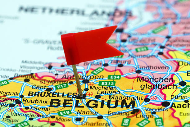 Brussels pinned on a map of europe Photo of pinned Brussels on a map of europe. May be used as illustration for traveling theme. belgium stock pictures, royalty-free photos & images