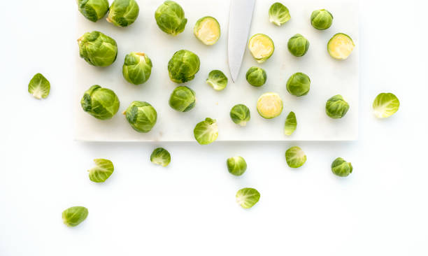 Brussels Sprouts and Knife on White Marble – Foto