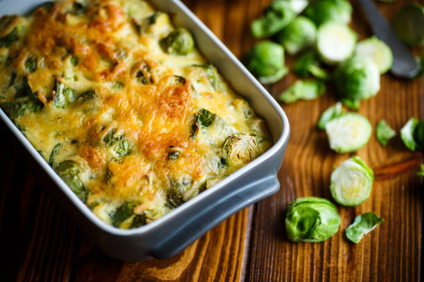 Brussels sprouts baked in sauce with cheese stock photo