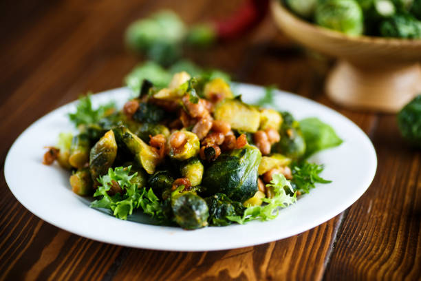 Brussels sprouts fried with beans close-up stock photo