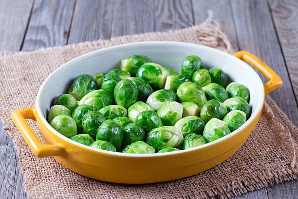 brussels sprouts in baking dish stock photo