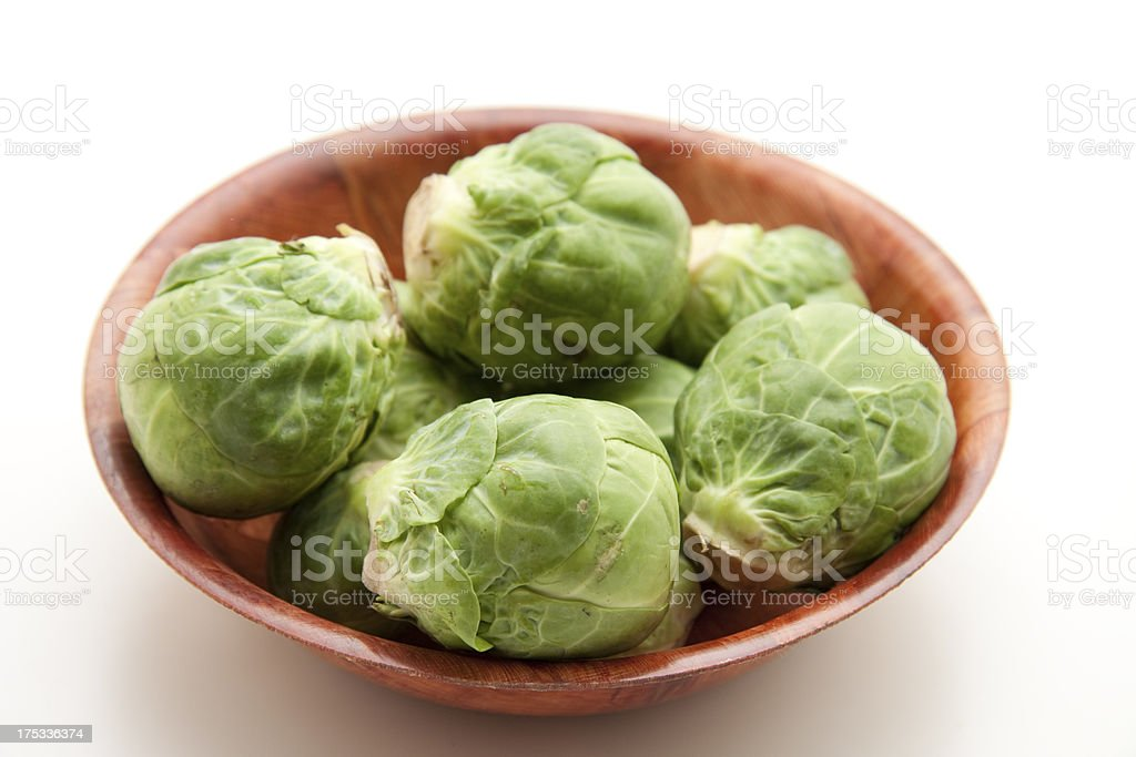 Brussels sprouts in wooden bowl royalty-free stock photo