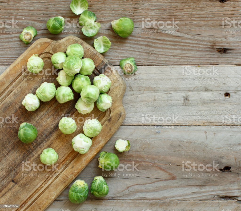 Brussels sprouts on a wooden board stock photo