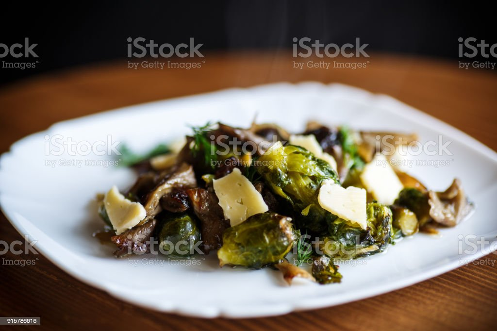 Brussels sprouts roasted with mushrooms stock photo