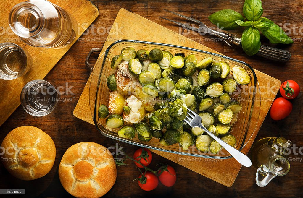 brussels sprouts roasted with potatoes and cheese stock photo