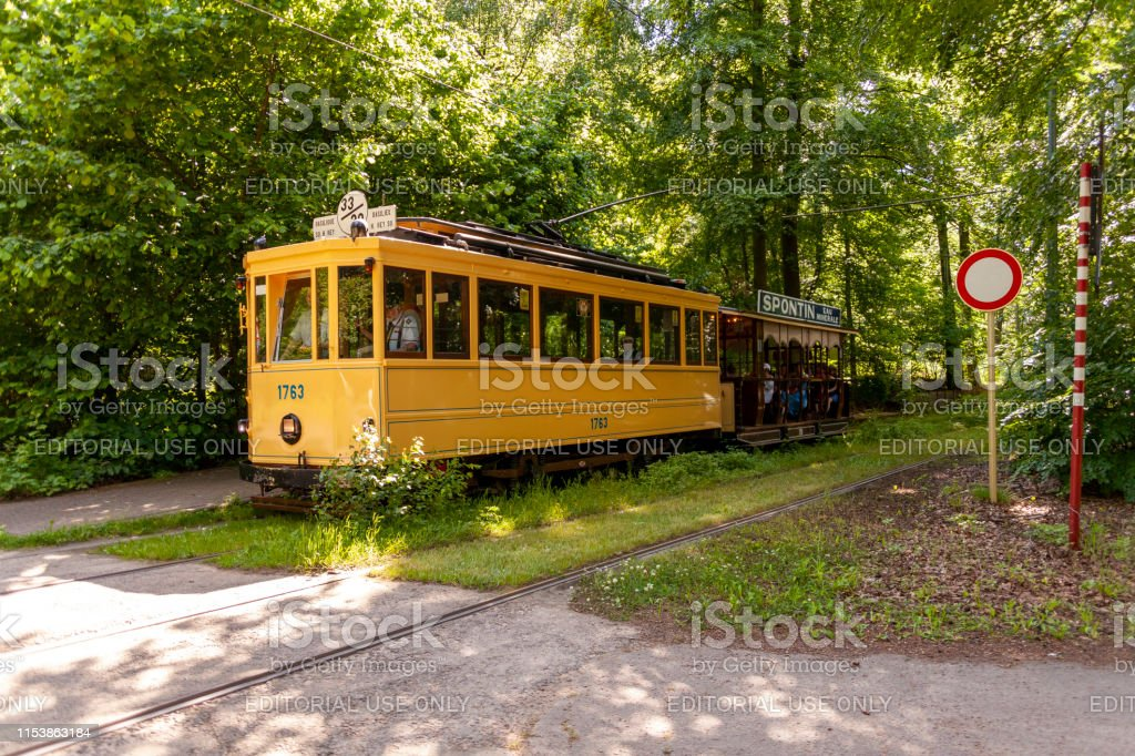 Brussels vintage tramways in the spring Brussels, Belgium - 6/2/2019: During the summer months, the green eastern part of Brussels is serviced by vintage tramways from the years 1900-1970. From April to September, local citizens of communes like Tervuren and Sint-Pieters-Woluwe get the chance to experience one of the dozen still operating vintage tramways. These serve the  regular trajectories. Ancient Stock Photo
