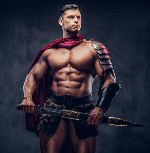 brutal ancient greece warrior with a muscular body in battle uniforms - warrior person stock pictures, royalty-free photos & images