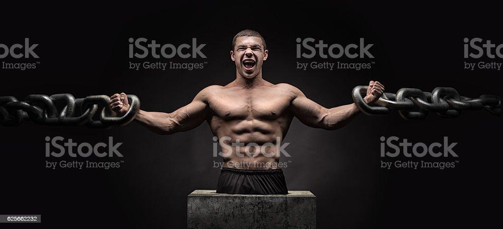 Brutal man bodybuilder athlete holding a chain stock photo