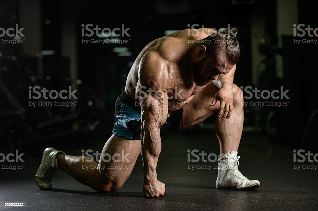 Brutal strong bodybuilder athletic men pumping up muscles with d stock photo