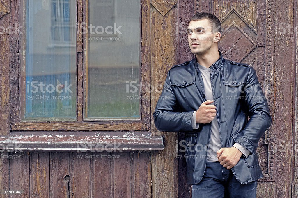 brutal young man in a leather jacket royalty-free stock photo