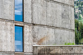 Brutalist architecture with concrete walls and glass windows abstract closeup of building