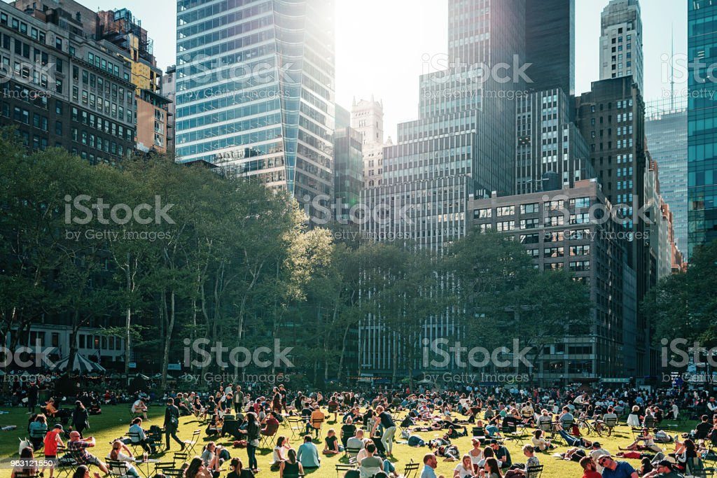 Bryant park near the Library in NYC crowded with people in the afternoon stock photo